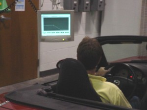 Photo: Driver watching computerized display showing  test schedule and driving statistics