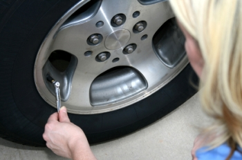 Person checking tire pressure